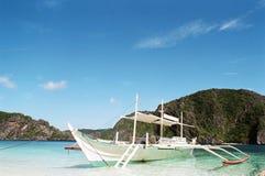 Boat at lagoon shore. Philippines tranditional boat, banca, docked at shore Royalty Free Stock Photos