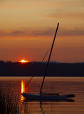 Boat at the lake. Sailboat anchored at the lave during beautiful sunset Stock Photo