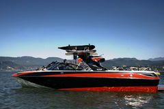 Boat on a lake. Boat with wakeboard boards standing still on alake Stock Photography