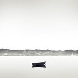 Boat on the lake. Lonely boat on the flat water surface Royalty Free Stock Image