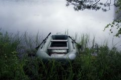 Boat on the lake. With some fog on the water Stock Photography