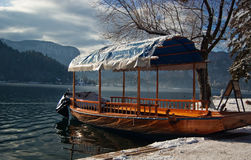 Boat by the lake. Boat by the Bled lake in winter royalty free stock images