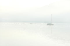 Boat on a lake. Early in the morning on a foggy lake Royalty Free Stock Image
