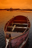 Boat on lake. A red boat on the lake Royalty Free Stock Photo