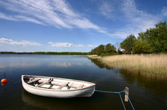 Boat on a lake. Fishing boat on a lake in denmark stock images