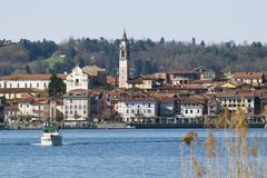 Boat on the lake. Arona viewed from Angera, Lago Maggiore Stock Photo