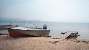Boat on lake Baikal shore Stock Images