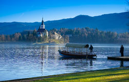 Boat on Lake Bled with island. Slovenia, Europe Royalty Free Stock Photos
