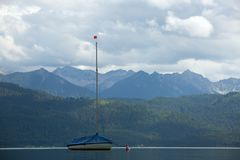 Boat on the lake. In Alps Stock Photo