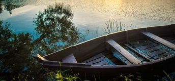 Boat in lake close up. Wooden boat in lake panorama royalty free stock image