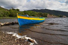Boat on the lake coast Royalty Free Stock Photography
