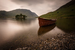 Boat at the Lake District in England. At the bottom of a green hill stock photo