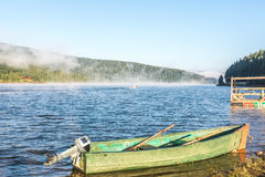 Boat on the lake early morning. In summer Royalty Free Stock Photos
