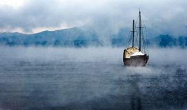 Boat, lake and Fog. A boat in the middle of the fog in the lake Royalty Free Stock Photography