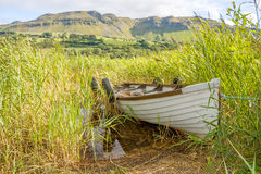 Boat in the lake. Boat in The Glencar lake in Ireland Stock Images