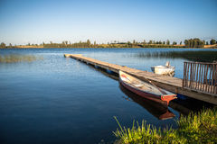 Boat at the lake in a gorgeous landscape Stock Photography