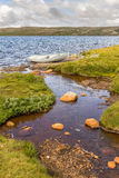 Boat in a lake in Hardangervidda, Norway Royalty Free Stock Image