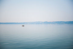 Boat on a lake in haze morning Royalty Free Stock Images