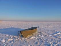 Boat on lake ice Royalty Free Stock Image