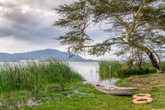 Boat and Lake Jipe at sunset, Kenya Stock Photography