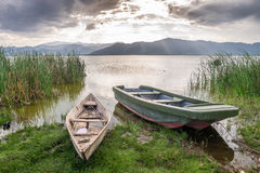 Boat and Lake Jipe at sunset, Kenya Stock Photo