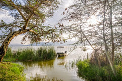 Boat and Lake Jipe at sunset, Kenya Stock Images