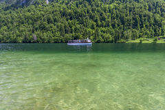 Boat on the lake. Konigsee. Germany. Boat sailing on the crystal clear lake Royalty Free Stock Photos