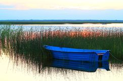Boat on the lake, Leba, Poland Royalty Free Stock Image