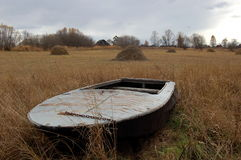 Boat on the lake. Boat lying on the shore of Lake Royalty Free Stock Photography