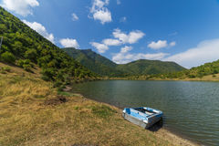 The boat on lake on montains background Stock Photo
