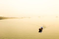 Boat on the lake at morning fog. Stock Photo