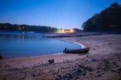 Boat on lake at night Stock Image