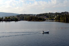 Boat on a lake in norway Royalty Free Stock Photo