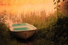 Boat. An lake with orange tones Royalty Free Stock Image