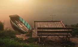 Boat on lake. Pier and boat on lake Stock Image