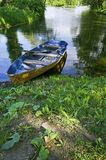 Boat at lake shore. In summer park in Saint Petersburg, Russia royalty free stock photography