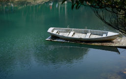 Boat on a lake shore Stock Images