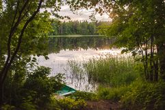 Boat on a lake in summer royalty free stock image