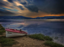 Boat on the lake on sunrise. Cigov Chark, Bulgaria Royalty Free Stock Photography