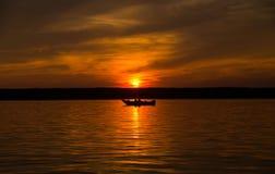 Boat on lake at sunset Royalty Free Stock Photos