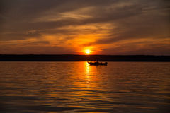 Boat on lake at sunset Royalty Free Stock Image