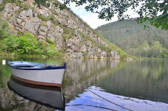 Boat on the lake. It is time to embark and we directly sit at the front of the boat, at which point we see that the sky begins to cloud over, so we only have royalty free stock photos