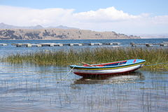 Boat on Lake Titicaca. Colorful boat on the scenic coast of Titicaca lake in Bolivia, South America Royalty Free Stock Images