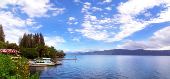 Boat and Lake Toba Panorama. Royalty Free Stock Photos