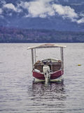 Boat on a lake. Tourist boat on a lake on winter Royalty Free Stock Photos