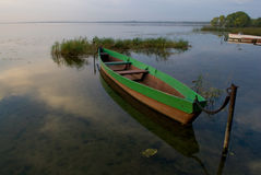 Boat and lake at twilight Stock Images
