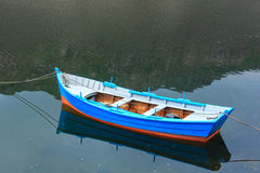 Boat on lake water surface. Stock Photography