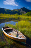 Boat on a lake. In a wetland area in the norwegian mountains royalty free stock image