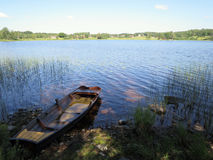 A boat in a lake. A wooden boat in a peaceful lake Royalty Free Stock Images