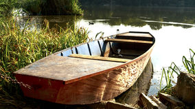 Boat at the lakes shore Stock Photos